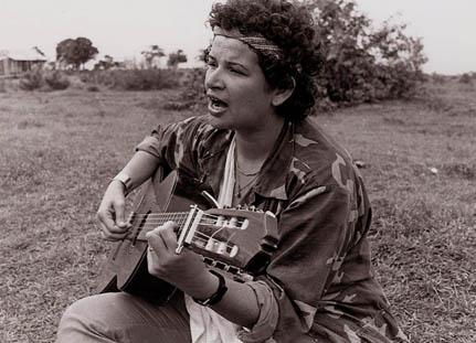 Norma Elena Gadea, singing in the fields near the Bismuna battlefield